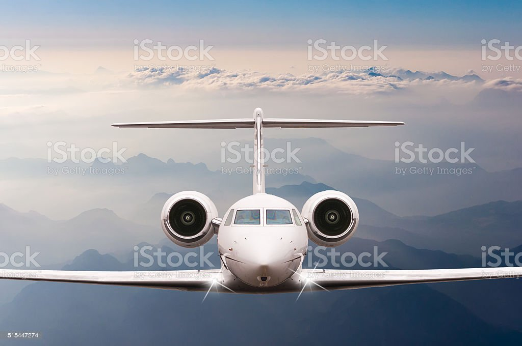 Private Airplane fly over clouds and Alps mountain on sunset stock photo