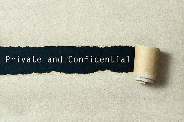 Private and confidential Private and confidential written on torn paper black background privacy stock pictures, royalty-free photos & images
