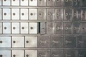 istock Private bank deposit box - close up of opened mailbox with a small key - post office box or PO BOX concept 1159568256