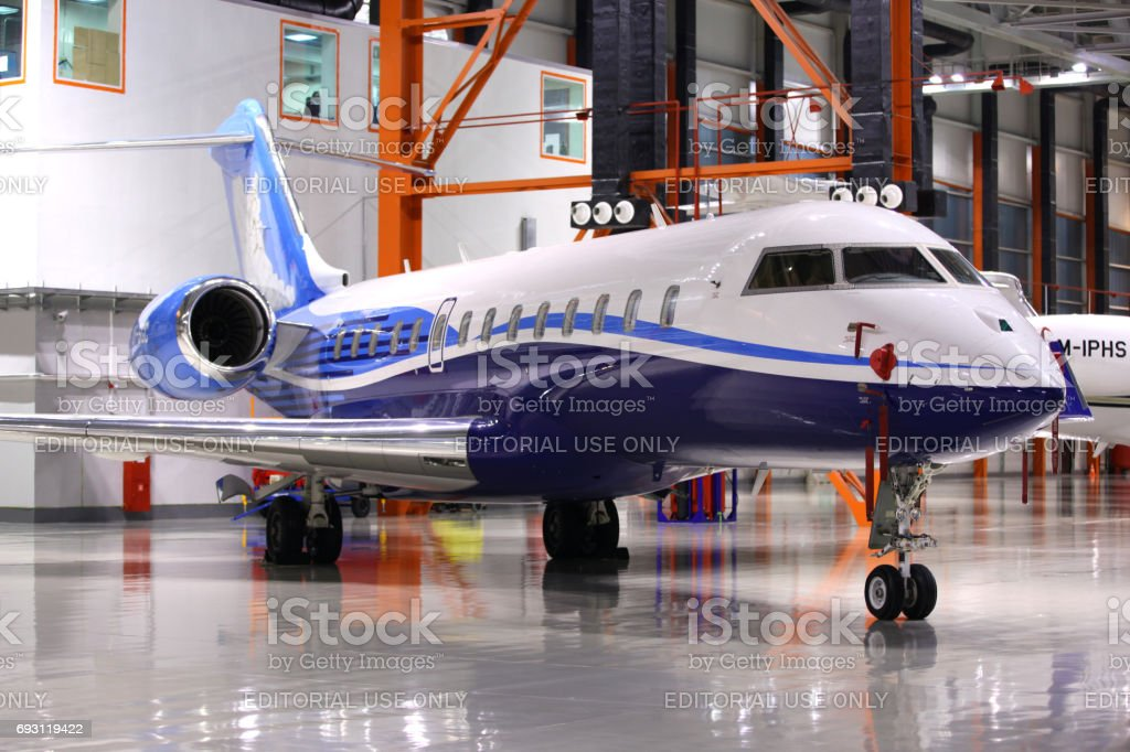 Private Bombardier Global 5000 OY-SGC standing in a hangar at Sheremetyevo international airport. stock photo