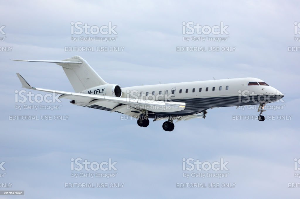Private Bombardier Global Express M-YFLY landing at Vnukovo international airport. stock photo