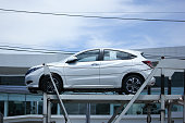 istock Private car, Honda HRV On trailer Truck. 584884252