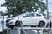 istock Private car, Honda HRV On trailer Truck. 584884274