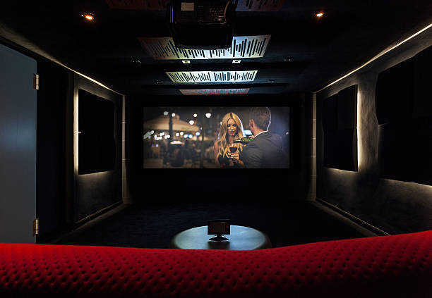 private cinema at modern house - projection equipment stock pictures, royalty-free photos & images