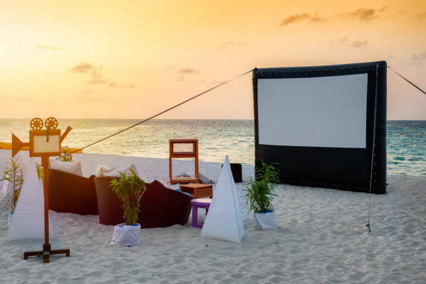 A private cinema setting on a tropical beach stock photo