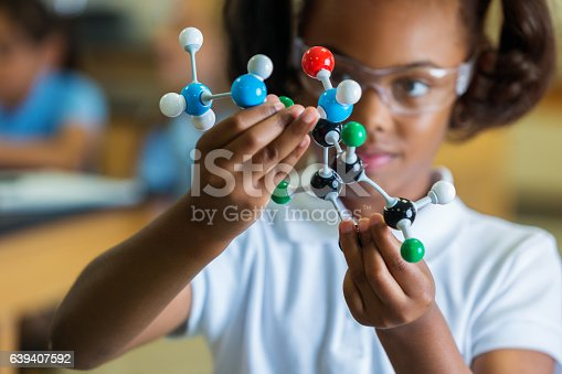 istock Private elementary school girl examines molecular structure 639407592