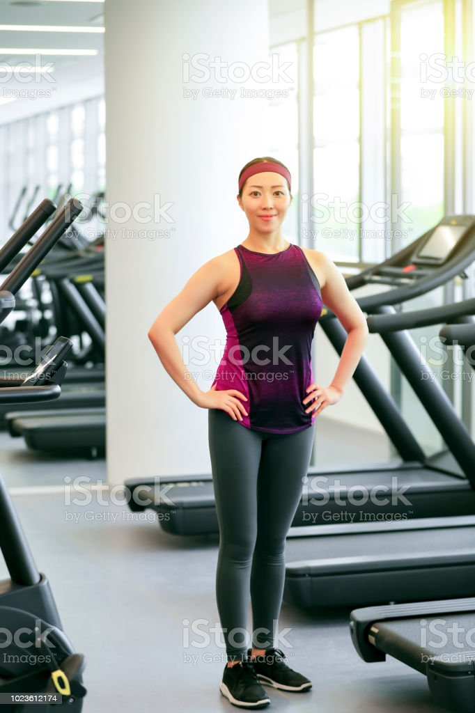 Private female coach shows her body in the gym