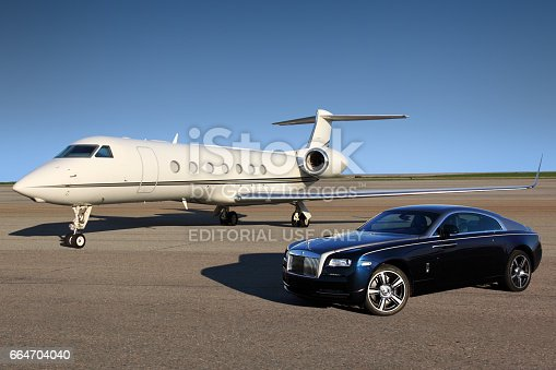 istock Private Gulfstream G550 executive airplane with Rolls Royce Wraith luxury car shown together at Sheremetyevo international airport. 664704040