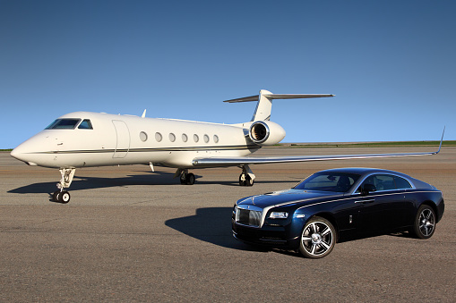 Private Gulfstream G550 Executive Airplane With Rolls Royce Wraith Luxury Car Shown Together At Sheremetyevo International Airport Stock Photo - Download Image Now