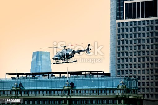 istock private helicopter flying around buildings 1186995551