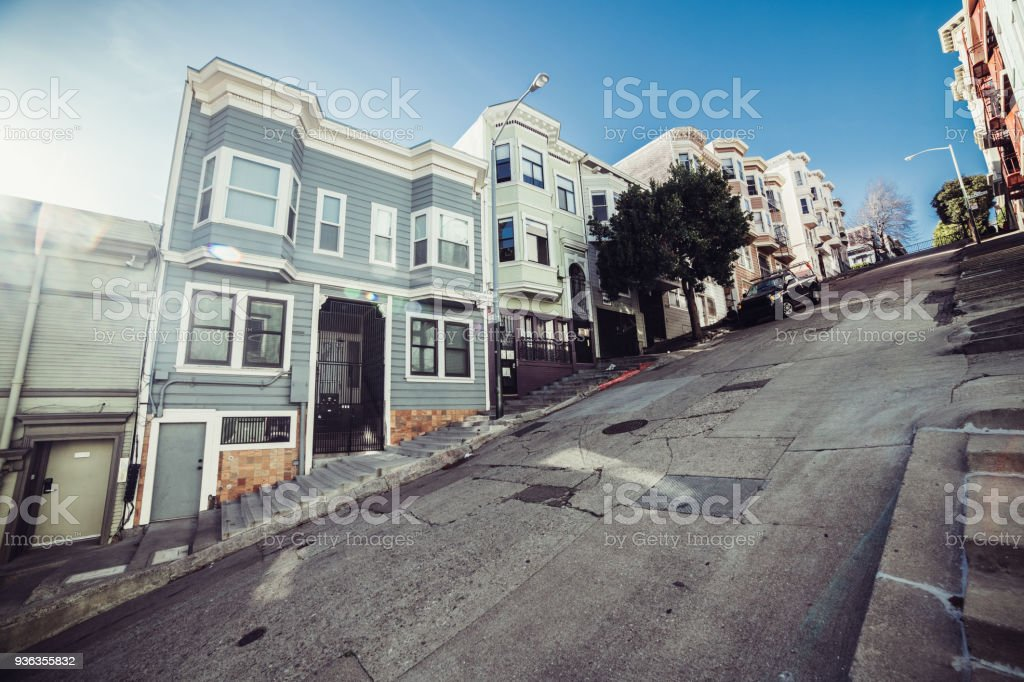 Private houses on city street with the big bias in San Francisco stock photo