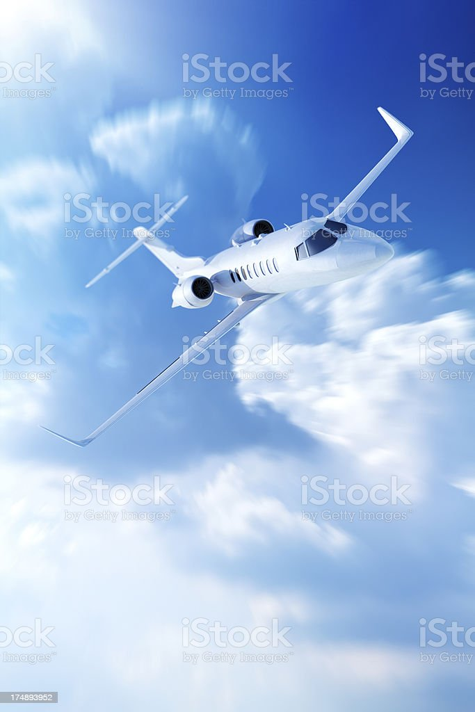 Private jet airplane in clouds stock photo