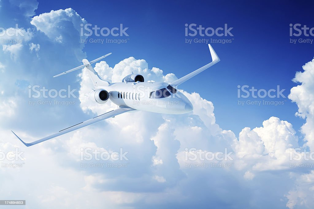 Private jet airplane in clouds royalty-free stock photo