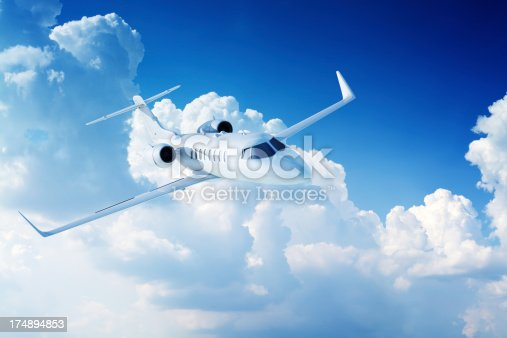 943681768 istock photo Private jet airplane in clouds 174894853