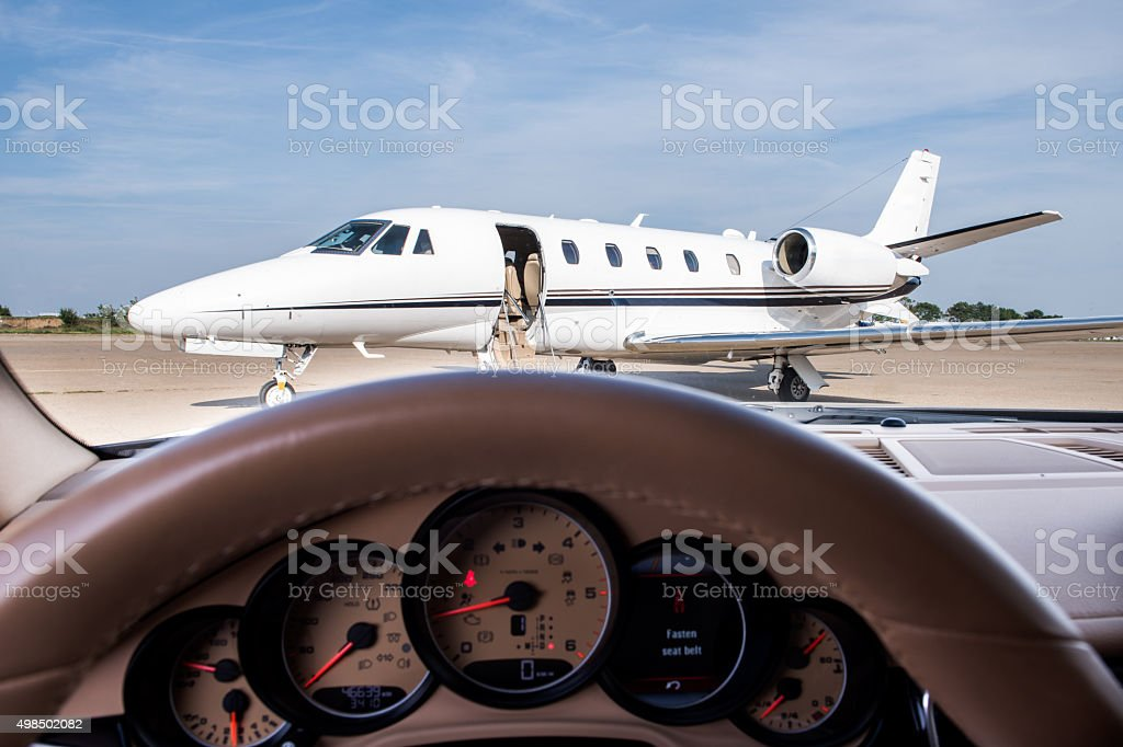 Private jet airplane viewed from the driver seat stock photo