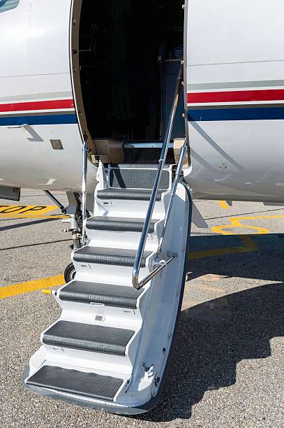 Private jet boarding stairs stock photo