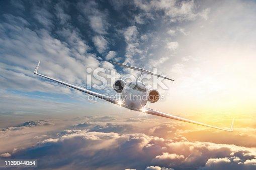 Private jet flying in blue sky