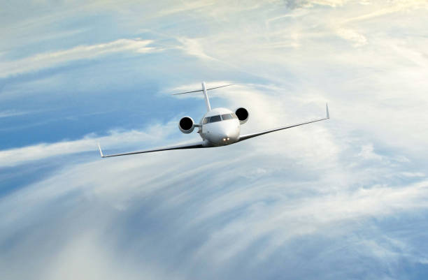 Private jet in the clouds stock photo