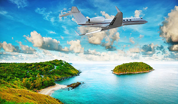 Private jet is leaving tropical resort stock photo