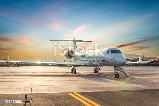 istock Private Jet On Airport Runway 1073242590