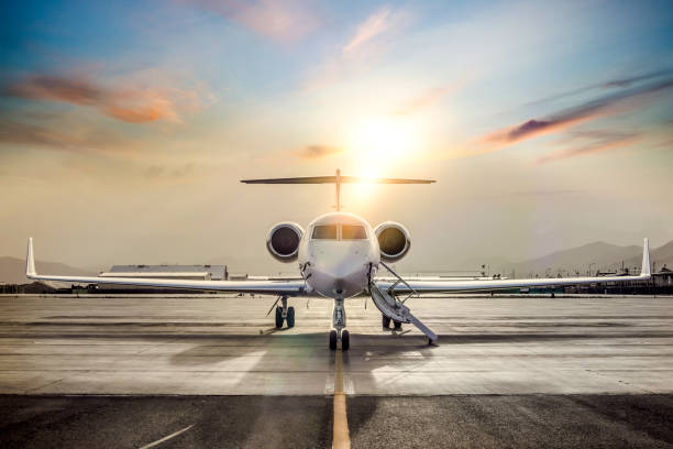 Private Jet On Airport Runway Private Jet On Airport Runway first class stock pictures, royalty-free photos & images
