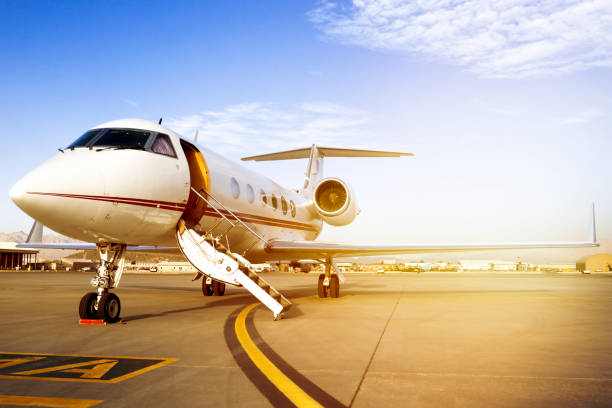 Private Jet On Airport Runway Private Jet On Airport Runway military private stock pictures, royalty-free photos & images