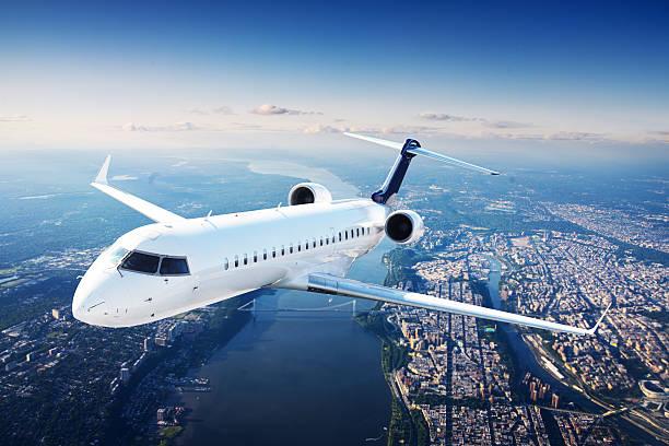 Private jet plane in the blue sky stock photo