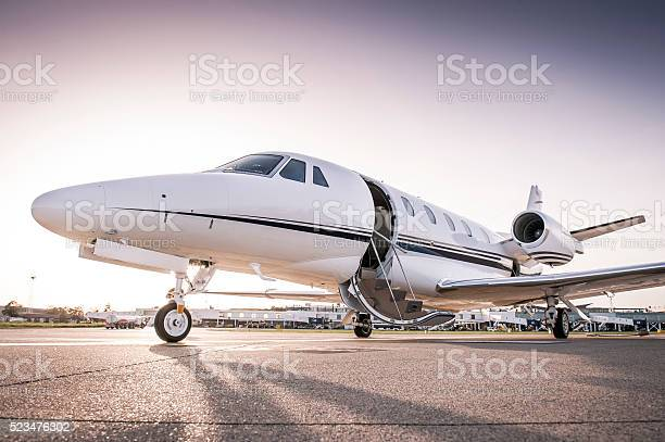 Luxury business jet with open door ready for passenger boarding