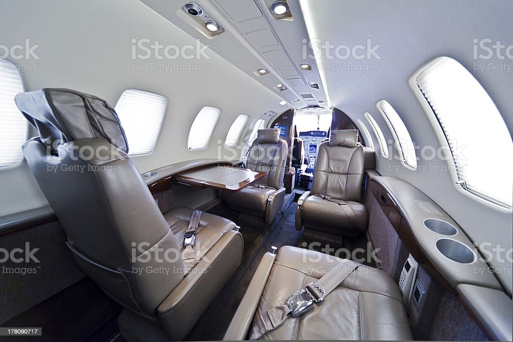 Private jet with leather seats stock photo