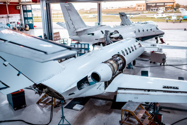Private jets for maintenance seen in the hangar stock photo