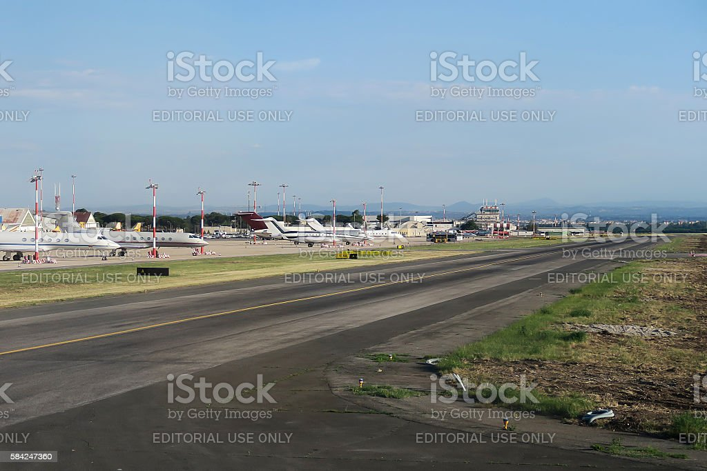 Private jets parked by the runway of Ciampino airport. stock photo