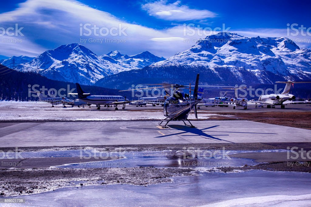 Private jets, planes and helicopters in the airport of St Moritz Switzerland stock photo