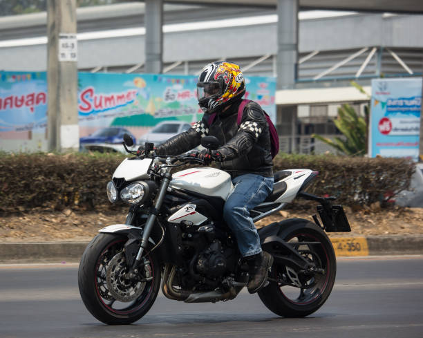 Private Man with Triumph Bigbike Motorcycle. Chiangmai, Thailand -  April 3 2020: Private Man with Triumph Bigbike Motorcycle. Photo at road no.121 about 8 km from downtown Chiangmai, thailand. bigbike stock pictures, royalty-free photos & images