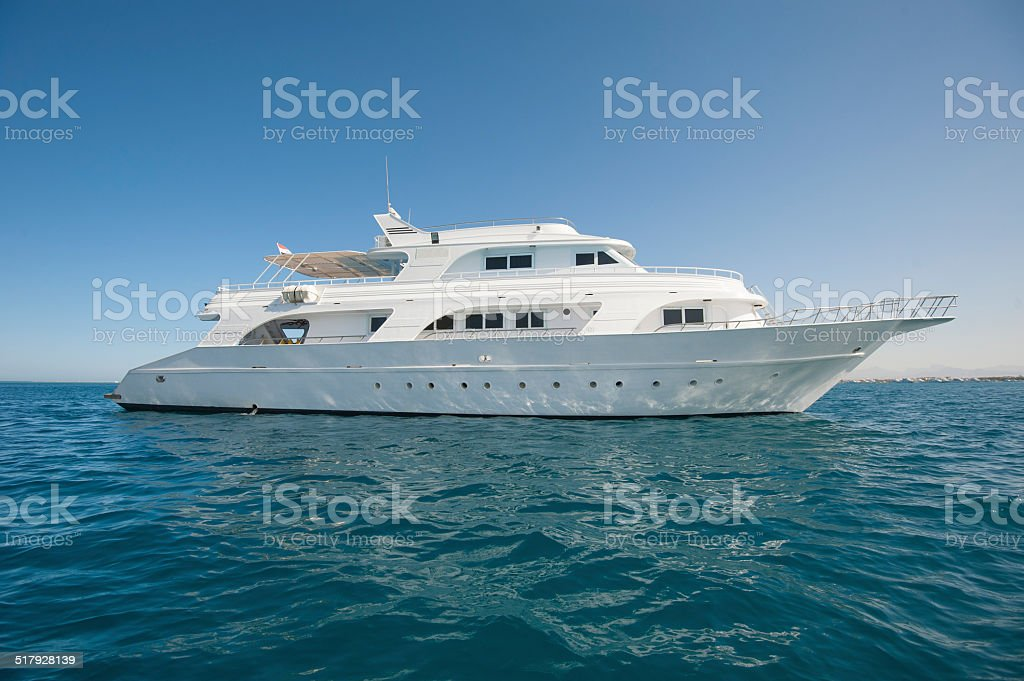 Private motor yacht at sea stock photo