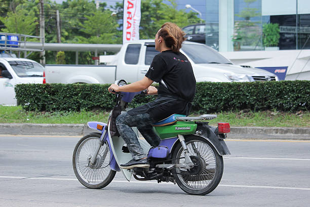 Private Old Kawasaki Motorcycle. Chiangmai, Thailand - June 27, 2016: Private Old Kawasaki Motorcycle. Photo at road no.121 about 8 km from downtown Chiangmai, thailand. kawasaki heavy industries stock pictures, royalty-free photos & images