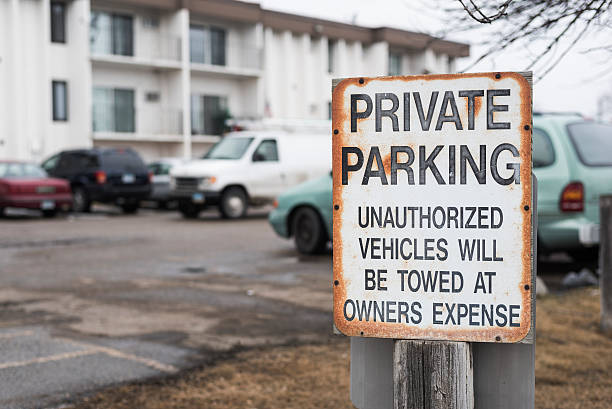 private parking with towing zone outside of building stock photo