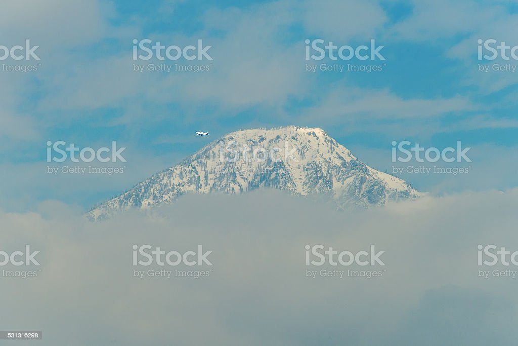 Private Plane Passes Mt. Baldy stock photo