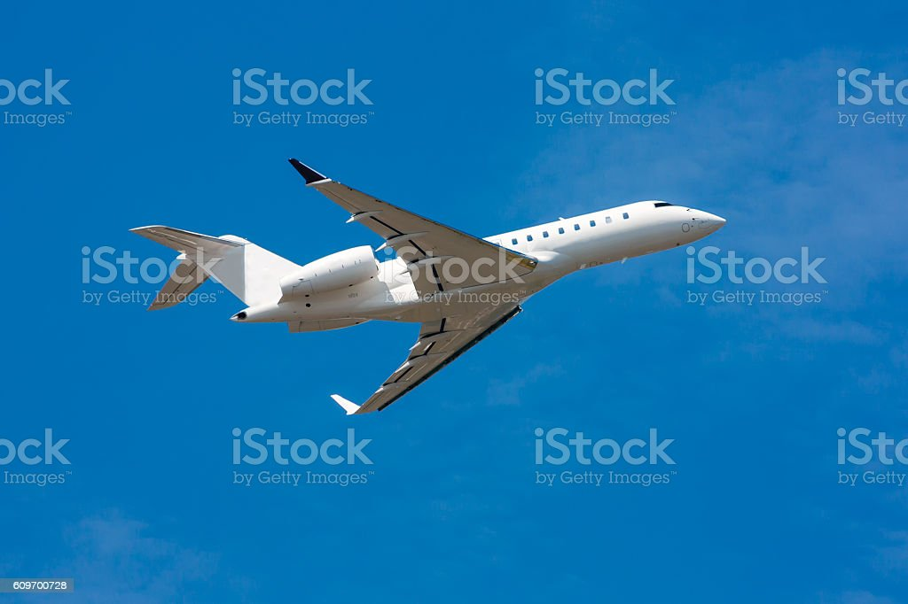 Private plane taking off and gear-up стоковое фото
