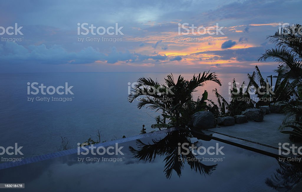 Private Poolvilla tropical Sunset with palm Silhouettes (XXXL) royalty-free stock photo