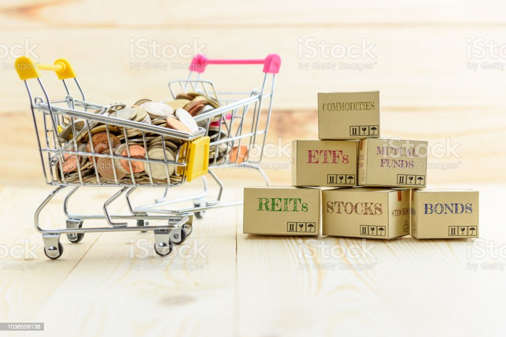 Private portfolio and wealth management with risk diversification concept : Paper boxes of financial instruments i.e ETFs, REITs, stocks, bonds, mutual funds, commodities and shopping cart with coins. stock photo