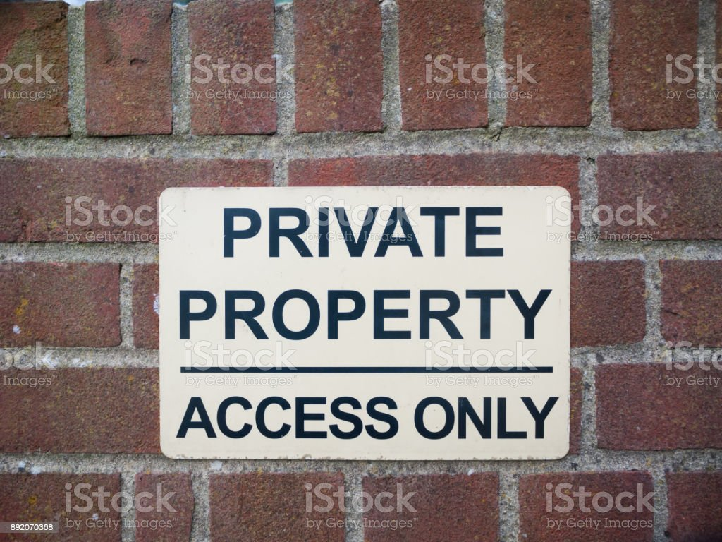 private property access only black and white sign on brick wall close up stock photo