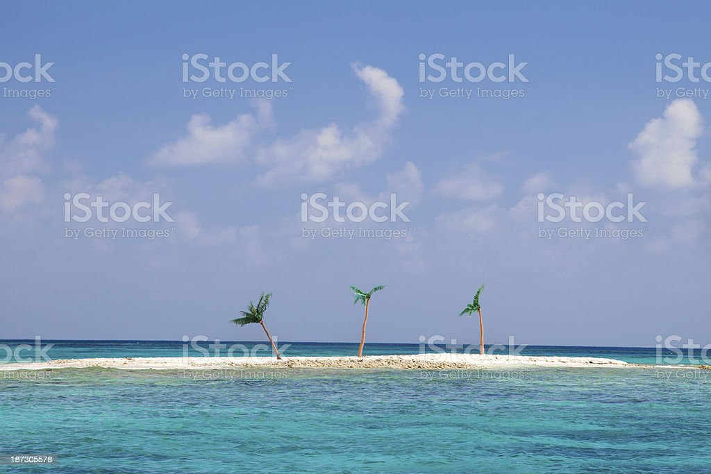 private sandbar with three fake palm trees in the Caribbean stock photo