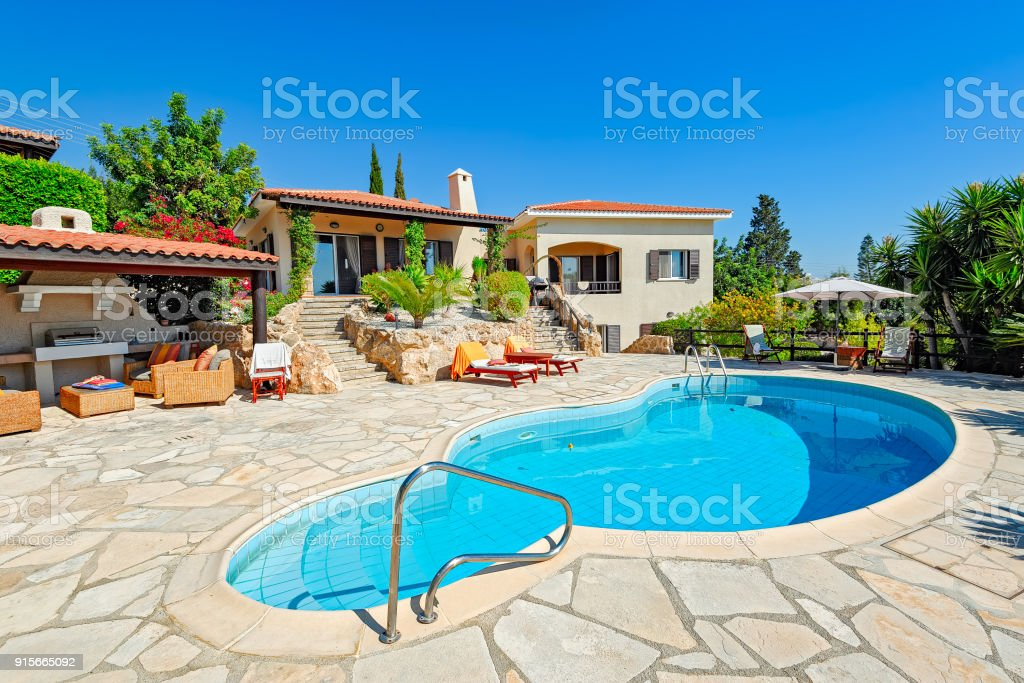 Private swimming pool and patio area royalty-free stock photo