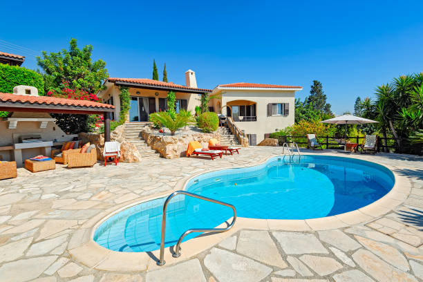 Private swimming pool and patio area stock photo