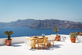 istock Private terrace with dining table overlooking the sea 1280511854