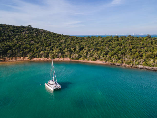 Private yacht cruising on tropical sea at evening stock photo