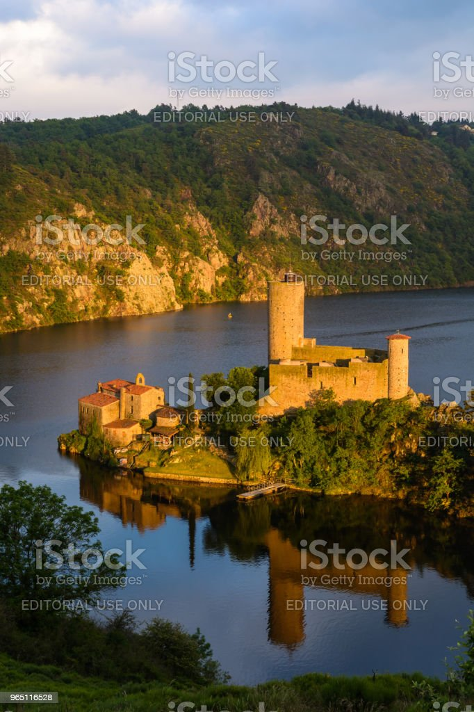 Privately owned, the Grangent castle stands on an island in the artificial lake resulting from the building of the Grangent dam on the Loire in 1957. zbiór zdjęć royalty-free