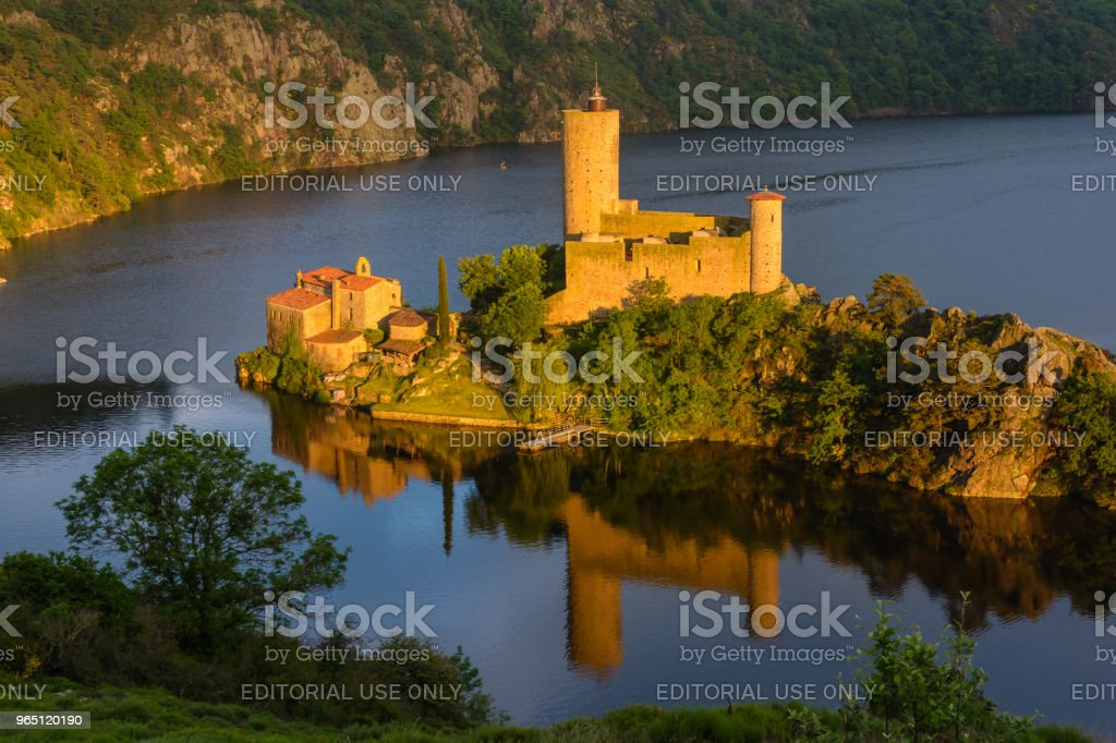 Privately owned, the Grangent castle stands on an island in the artificial lake resulting from the building of the Grangent dam on the Loire in 1957. royalty-free stock photo