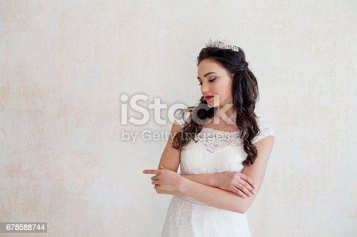 674214372istockphoto prncessa with the Crown bride wedding dress 678588744