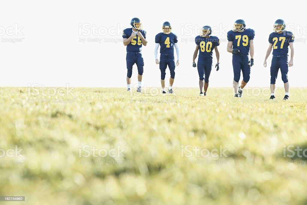 pro American footballers in blue uniform on a field royalty-free stock photo